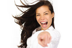 Excited woman pointing. Beautiful, excited and energetic young woman pointing at camera Stock Photography
