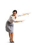 Excited woman pointing at something Stock Image