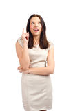Excited woman pointing up Royalty Free Stock Photography