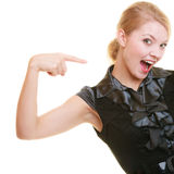 Excited woman pointing at your product. Royalty Free Stock Photos