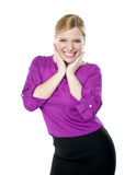 Excited woman posing with hands on chin Royalty Free Stock Images