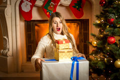 Excited woman posing with stack of Christmas gift boxes Stock Photos