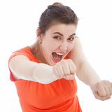 Excited woman punching with her fists stock images