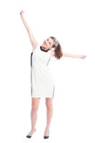 Excited woman raising arms up Stock Photo