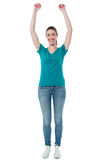 Excited woman raising her arms up Royalty Free Stock Image