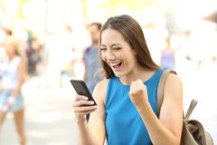 Excited woman reading amazing news on line Stock Images