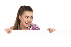 Excited Woman Reading Poster Royalty Free Stock Photo