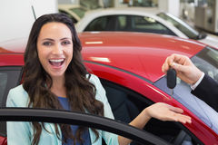 Excited woman receiving car key Stock Image