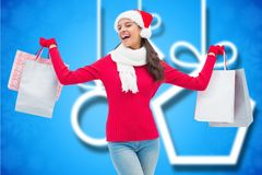 Excited woman in santa costume holding shopping bags Royalty Free Stock Photo