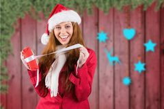 Excited woman in santa costume opening christmas gift Royalty Free Stock Photo