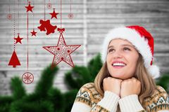 Excited woman in santa hat against digitally generated background Royalty Free Stock Image