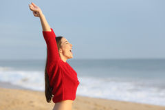 Excited woman screaming on the beach Stock Images
