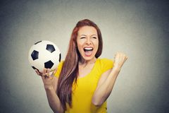 Excited woman screaming celebrating football team success. Portrait excited woman screaming celebrating team success holding football Royalty Free Stock Photography