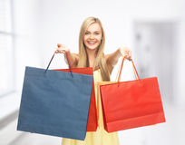 Excited woman with shopping bags Stock Photography