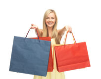 Excited woman with shopping bags Stock Images