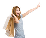 Excited woman shopping with hand pointing up Royalty Free Stock Photo