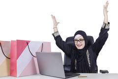 Excited woman shopping online Royalty Free Stock Images