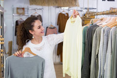 Excited woman shopping pullover Royalty Free Stock Photos