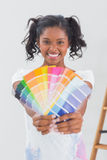 Excited woman showing colour charts Stock Photo