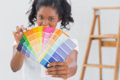 Excited woman showing colour charts Stock Images