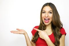 Excited woman showing and pointing your product on white background. Happy woman showing open hand palm and pointing. With her finger the copy space for product Royalty Free Stock Photos