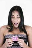 Excited woman with small box. Excited woman with small pink box Royalty Free Stock Images