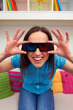Woman in 3d glasses sitting on sofa. Excited woman in stereo glasses sitting on sofa and watching the 3d film Royalty Free Stock Photo