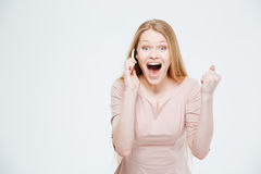Excited woman talking on the phone Stock Photo