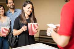 Excited woman about to see a movie Royalty Free Stock Photo