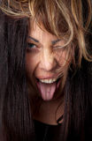 Excited woman with tongue out Royalty Free Stock Images