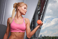 Excited woman training outdoors. Royalty Free Stock Photos