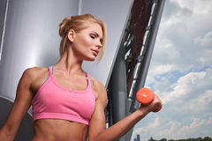Excited woman training outdoors. Stock Photography