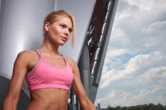 Excited woman training outdoors. Royalty Free Stock Image