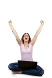 Excited woman using laptop stock photos