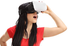 Excited woman using a VR headset Royalty Free Stock Photo