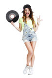 Excited Woman with Vinyl Record Showing Victory Sign Royalty Free Stock Images