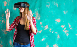 Excited woman watching though the VR device Stock Image