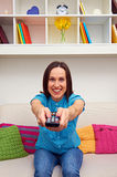 Excited woman watching tv Royalty Free Stock Photos