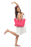 Excited woman in white dress raise her arm. Ready to go for holiday. summer concept Royalty Free Stock Photography