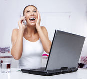 Excited woman working Stock Image