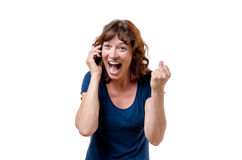 Excited woman yelling on her mobile phone Stock Photography