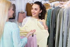 Excited women buying pullover and skirt Royalty Free Stock Images