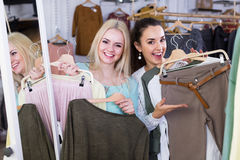 Excited women buying pullover and trousers Stock Photography