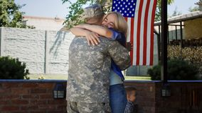 Loving family meeting soldier back at home royalty free stock photo