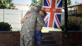 Loving family meeting soldier back at home stock images