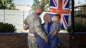 Loving family meeting soldier back at home royalty free stock photos