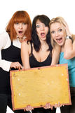 Excited women holding a board Stock Photography