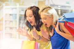 Excited women at the shopping center Stock Photo