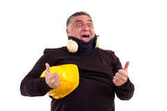 Excited worker screaming. Excited worker with  thumbs up for victory screaming of joy isolated on white background Stock Photography