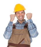 Excited worker wearing hard hat Royalty Free Stock Images